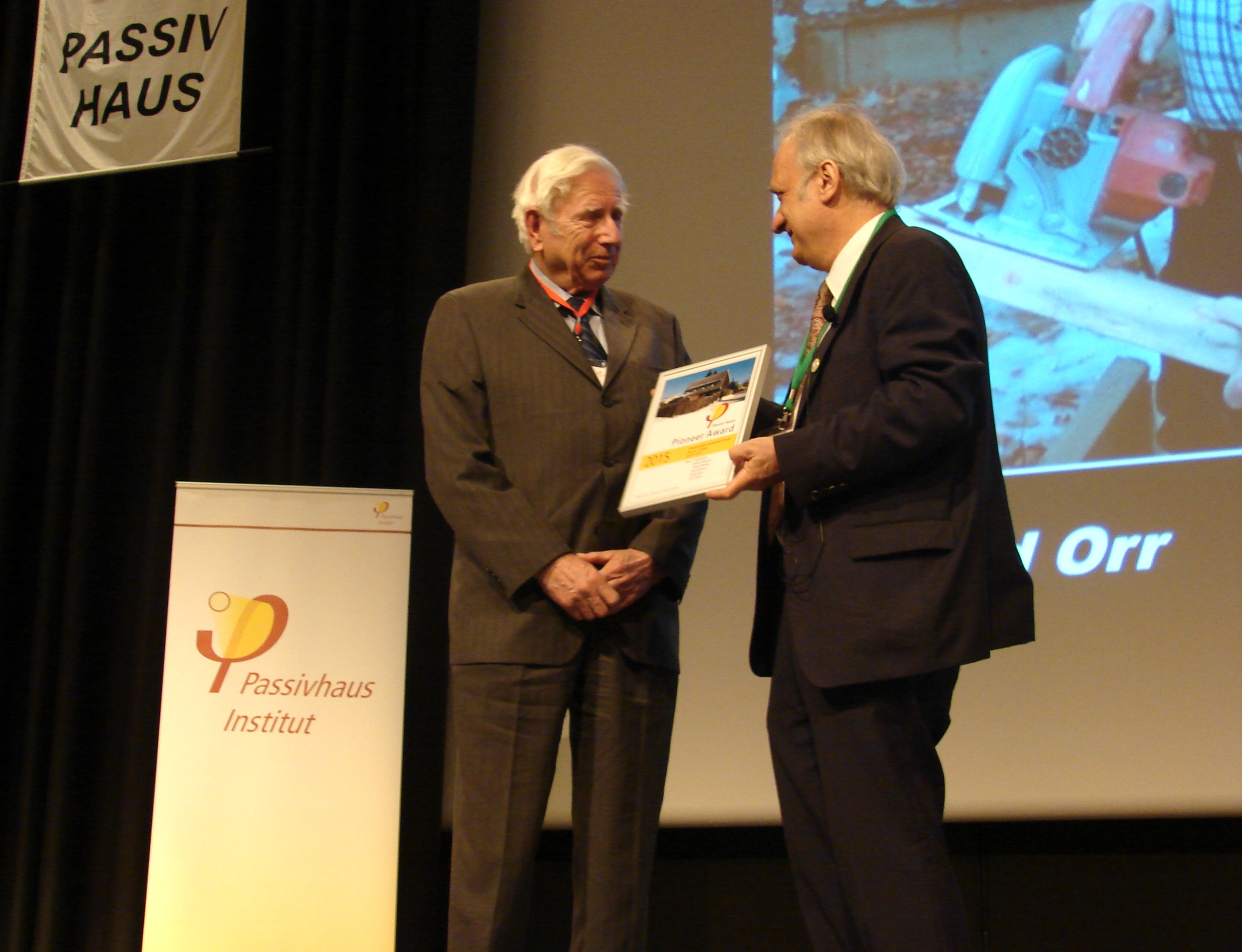 Dr. Feist presents award to Harold Orr